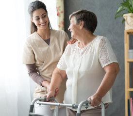 caregiver assisting the elder woman