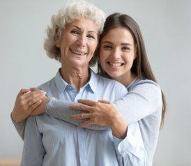 caregiver hugging the elder woman