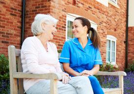 caregiver and a senior woman talking