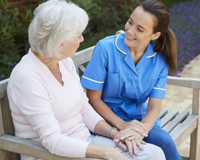 a caregiver comforting a senior woman