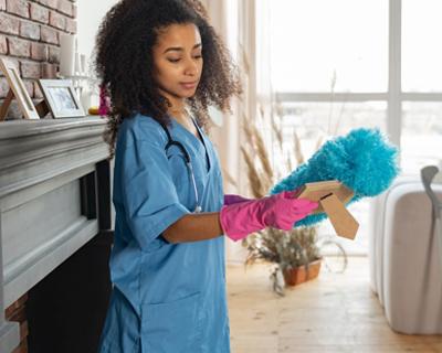 a caregiver doing house chores
