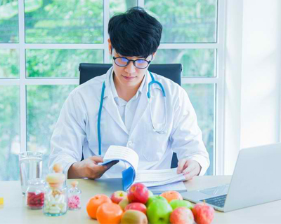 a doctor reading with fruits on his table