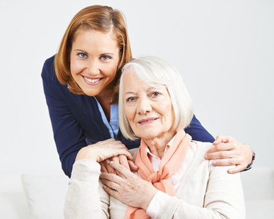 a medical social worker and a senior woman smiling