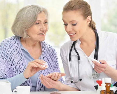 a doctor giving medicine to a senior woman