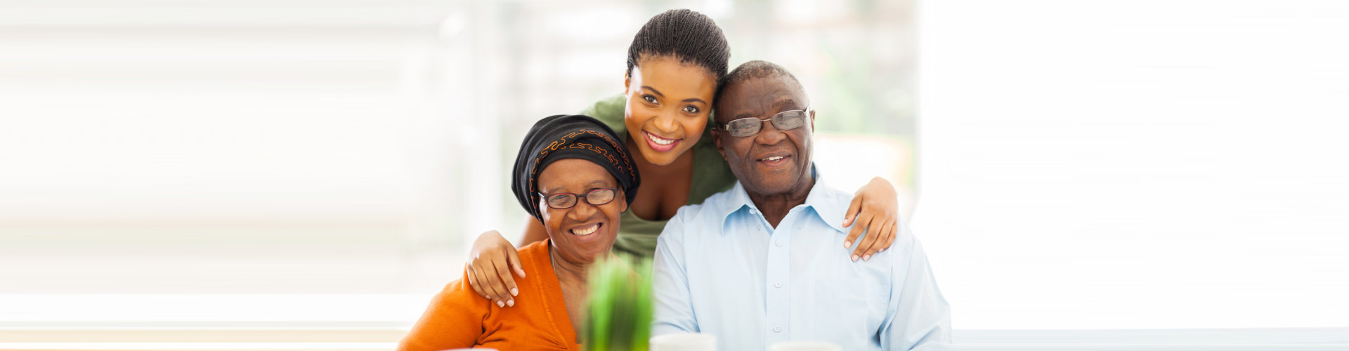 happy elder couple with their caregiver